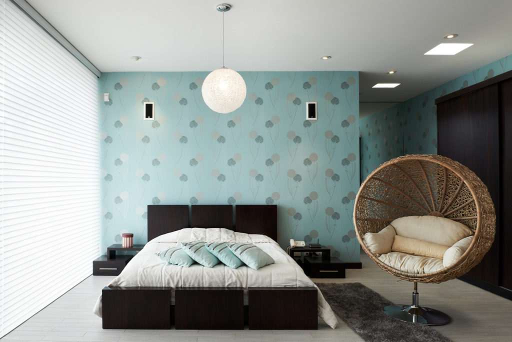 teal wallpaper bedroom with big screen