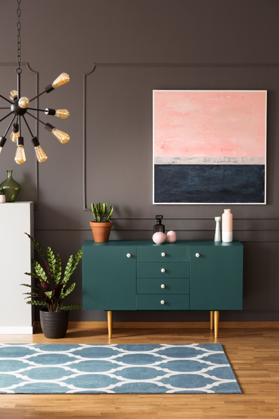 dark greige wall with green sideboard