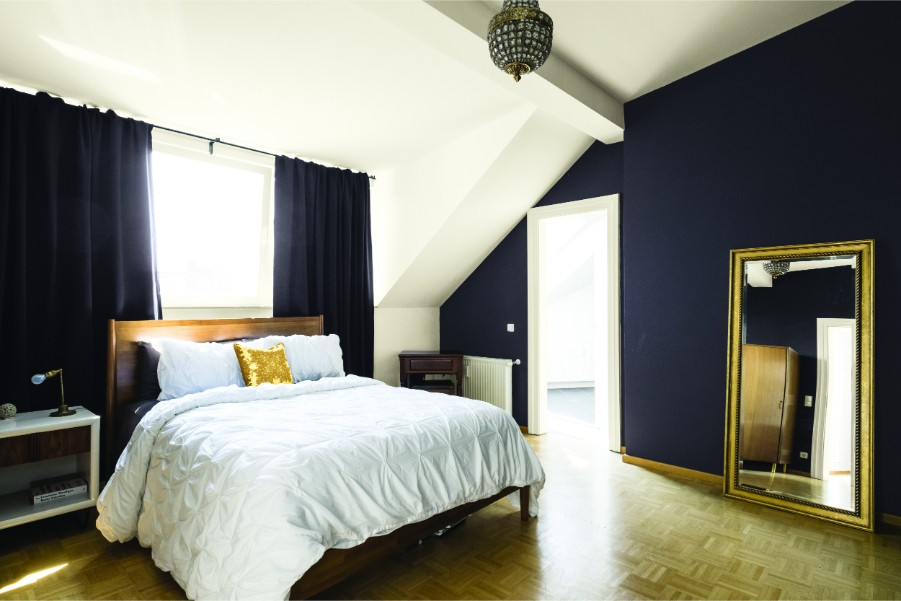 bedroom dark accent wall vaulted ceilings