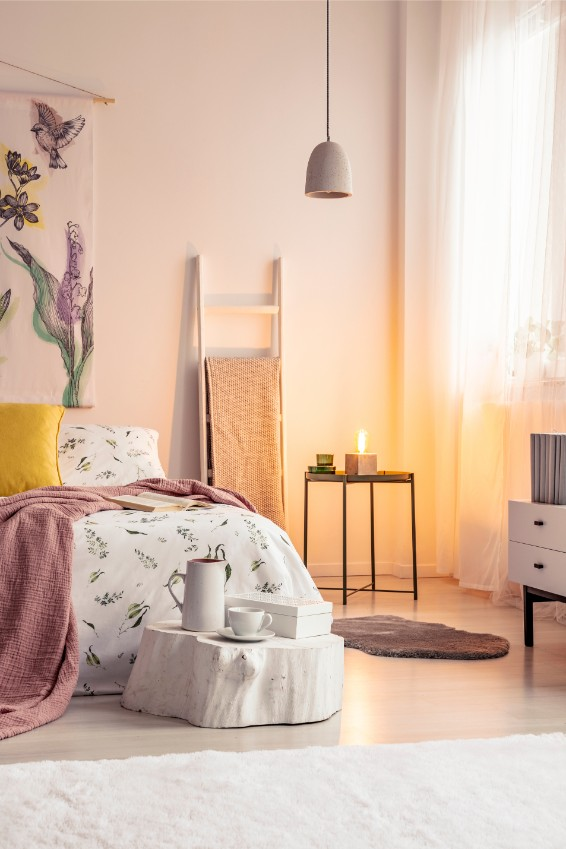 pink and beige bedroom with candle