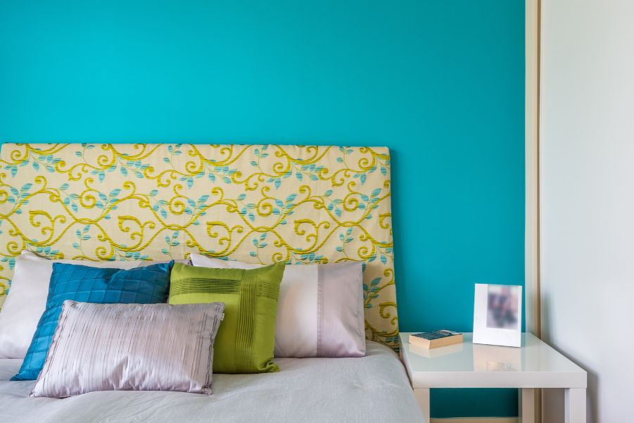 bright aqua accent wall bedroom