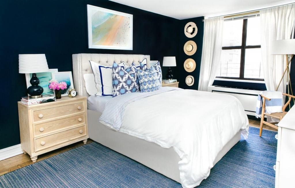 Upper East Side Bedroom with Dark Blue Accent Wall