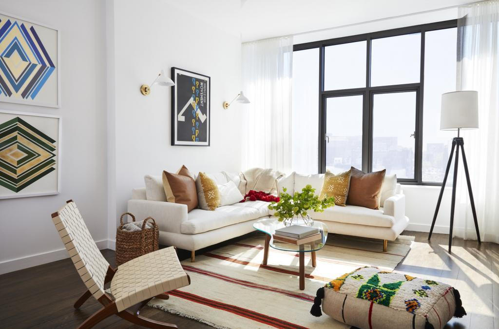 Simple NYC Living Room with White Walls and Colorful Pattern Accents