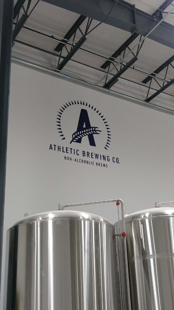 Athletic Brewing Company Logo on Production Wall