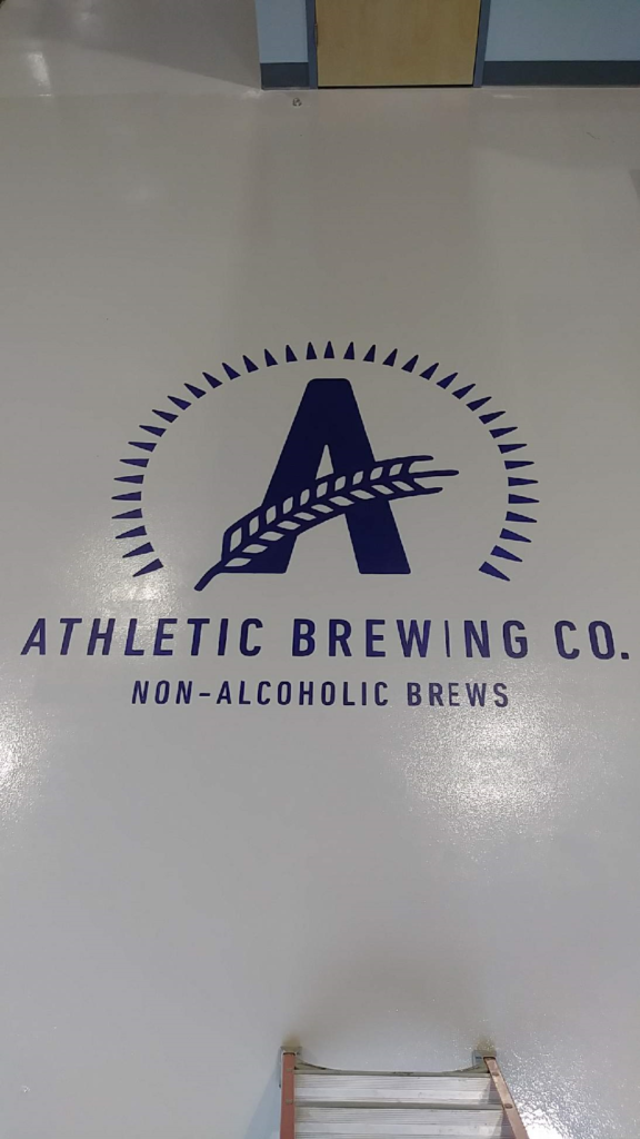 Athletic Brewing Company Logo in Tap Room