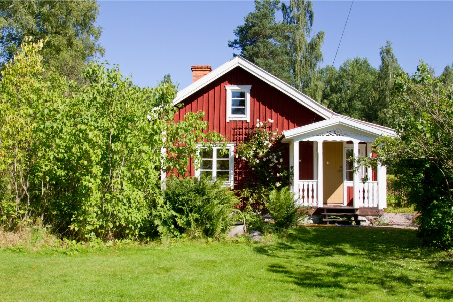 red cottage in wooded area