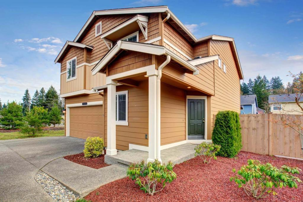 Brown Suburban House with Beige Trim