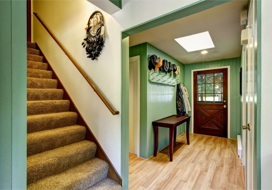 green foyer with staircase