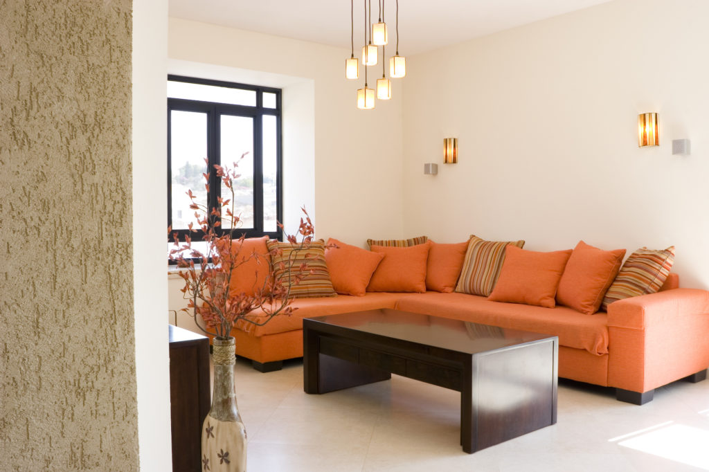 Light Orange Walls with Orange Couch - Feng Shui Colors