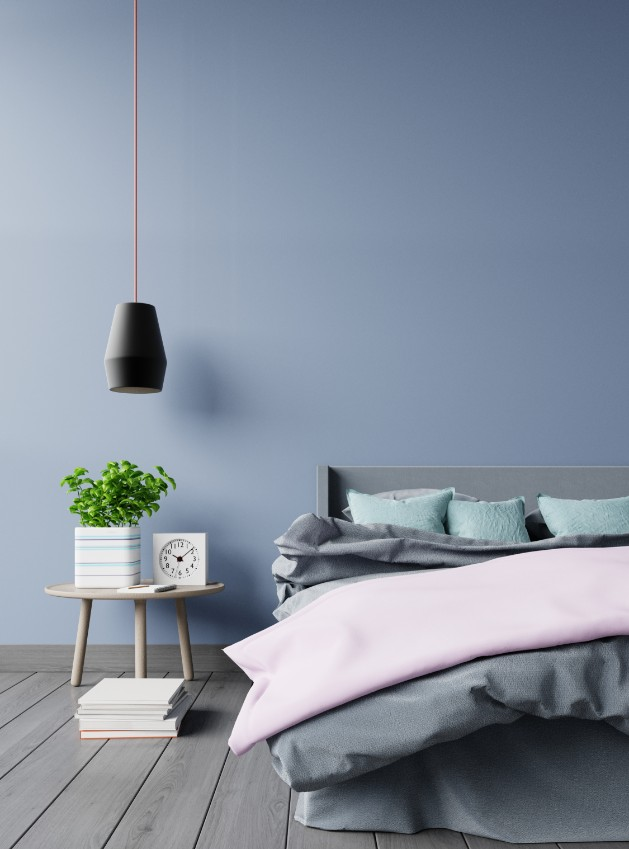 light gray blue painted wall gray bed