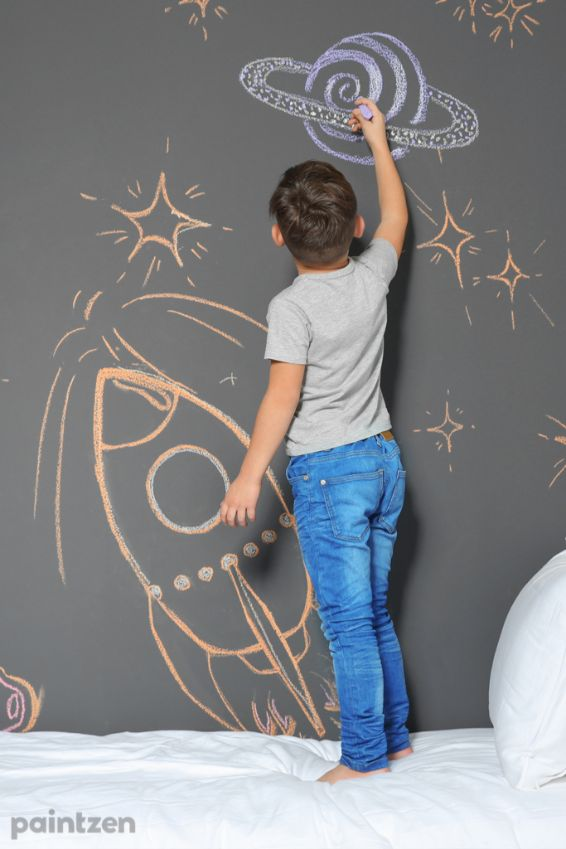 kid drawing chalk wall