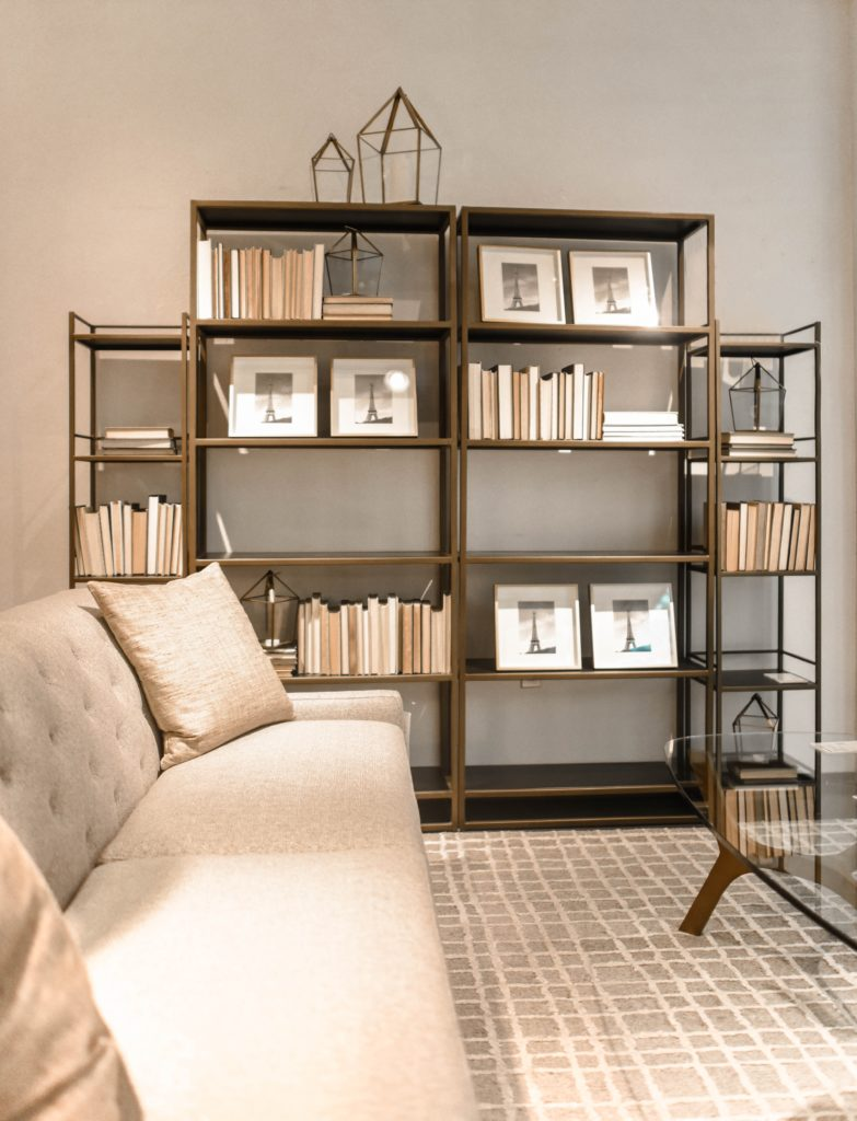 beige walls with bronze bookshelf