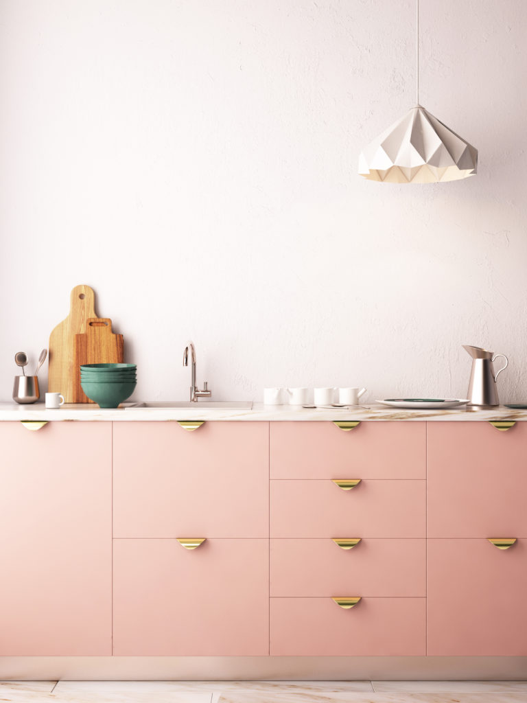 pink kitchen cabinets with gold accents