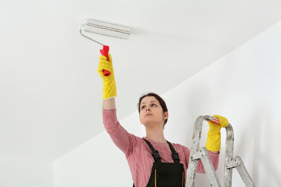 person painting ceiling